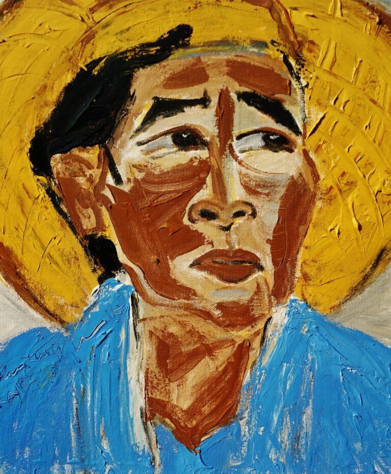 Painting titled 'Karsupi' depicts a portrait of the woman wearing a blue shirt and a conical hat.